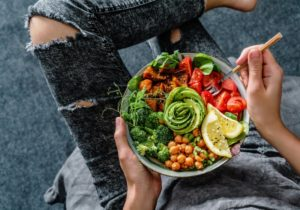 Eating salad, wondering how a vegan diet affects oral health